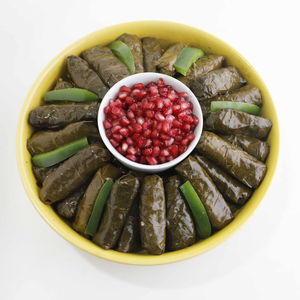Grape leaves stuffed with brown rice & Pomegranate molasses